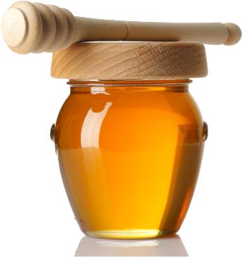 staklena tegla meda sa drvenim čepom.